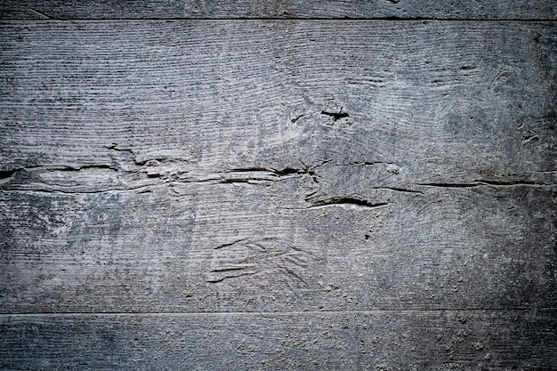 Texture background gray old dirty board with cracks, horizontal line
