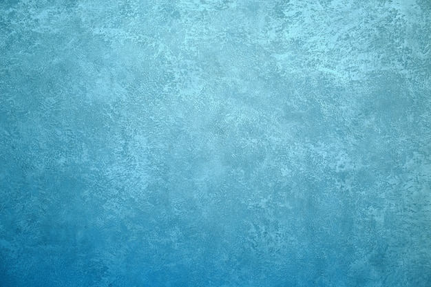 Texture background image turquoise wall with silvery or metallic shining plaster