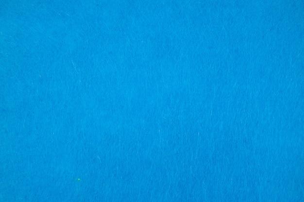 Текстура фона из светло-синего бархата или фланели в качестве фона или обоев для украшения