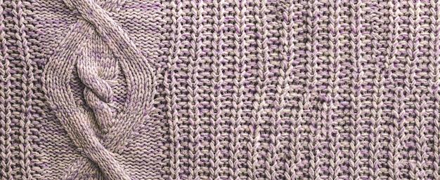 紫のニット生地のセーターのテクスチャ背景、マクロテキスタイルバナーと背景、居心地の良い家のパターン写真