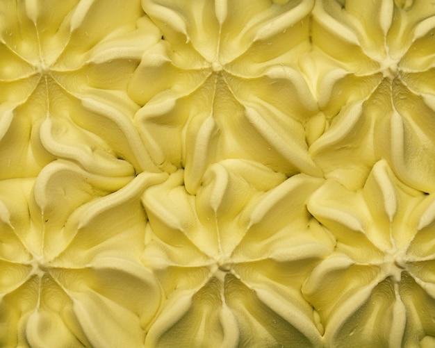優しい緑色のアップルミントピスタチオアイスクリームのテクスチャ背景パターン。上面図。フラットレイ。甘い生活、おいしい食料生産のコンセプト