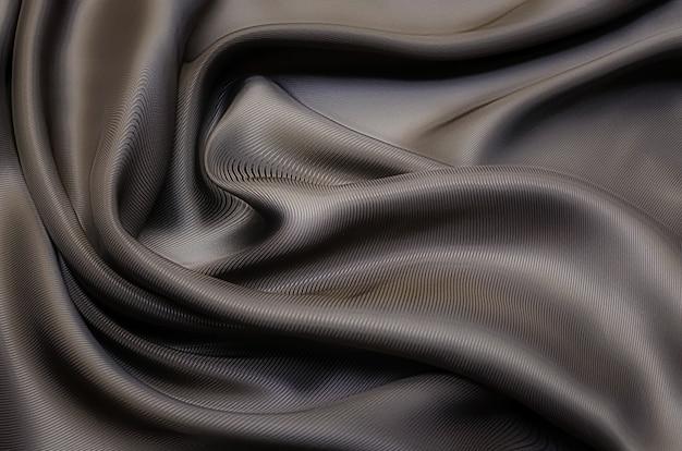질감, 배경, 패턴입니다. 베이지색 또는 갈색 실크 또는 면 또는 양모 직물의 질감. 패브릭의 아름다운 패턴입니다.