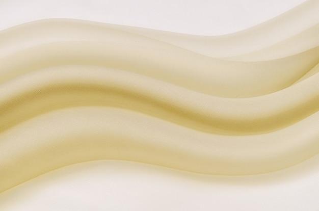질감, 배경, 패턴입니다. 노란색 또는 베이지색 실크 또는 면 또는 양모 직물의 질감. 패브릭의 아름다운 패턴입니다.