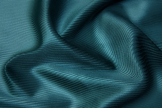 Texture, background, pattern. texture of tidewater blue or tranquil silk fabric. beautiful tidewater or tranquil soft silk fabric.