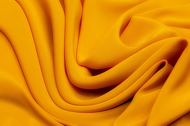 Texture background pattern texture of yellow or golden silk or cotton or wool fabric