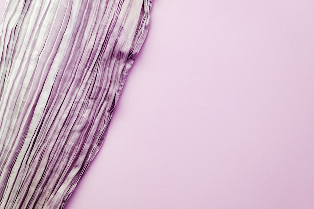 The texture of the background picture the lilac corrugated fabric with parallel or diagonal folds on textured paper