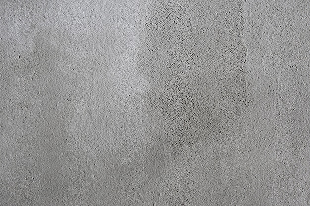 Texture background rough plastered grey wall, uneven surface treated with cement