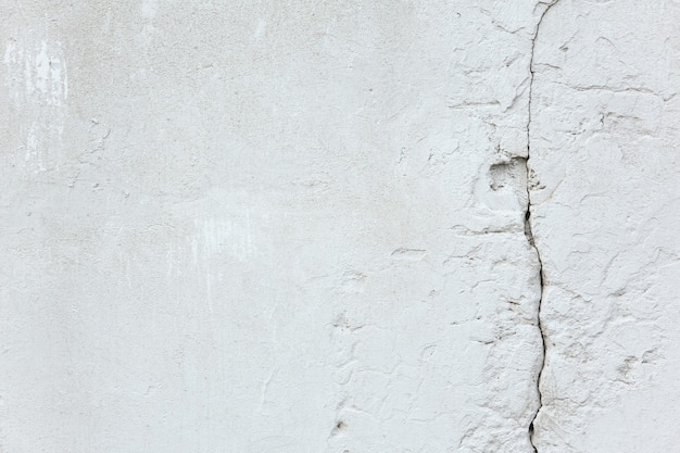 Texture and background white old concrete wall with crack repair and construction