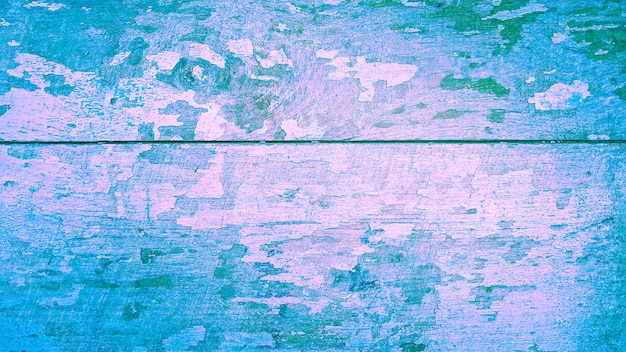 Texture background of wooden with pink and blue gradinet color