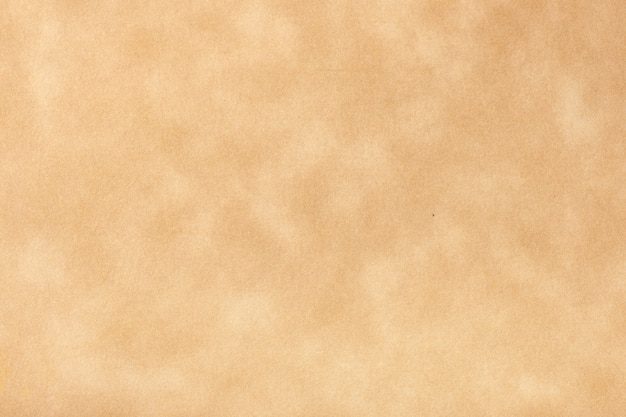 Texture of beige old paper, crumpled background. vintage brown grunge surface backdrop. structure of craft parchment cardboard.
