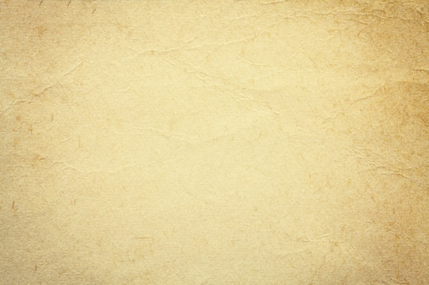 Texture of beige old paper, crumpled background. vintage sand grunge surface backdrop.