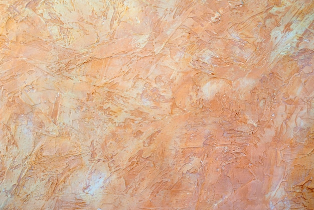 Texture of beige plaster. rough wall of the building.