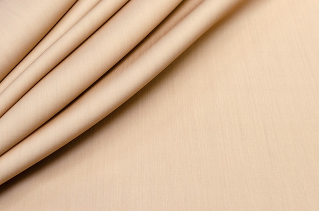Texture,  beige silk fabric with wool for sewing clothes.