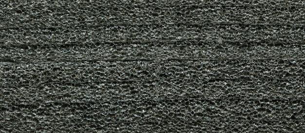 Texture of black foam rubber background
