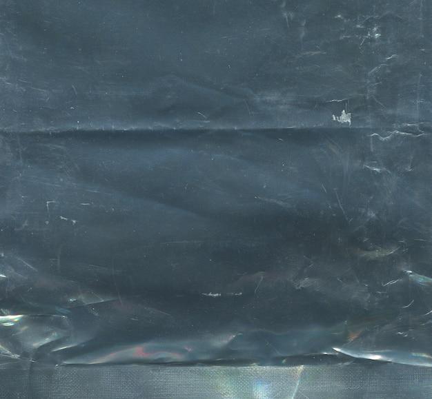 Texture of black scratched polyethylene background