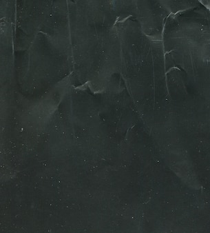 Texture of black shabby paper background