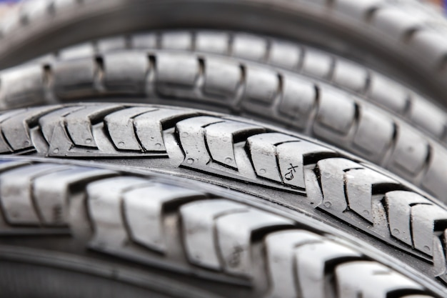 Texture of black tires in car repair shop close up.