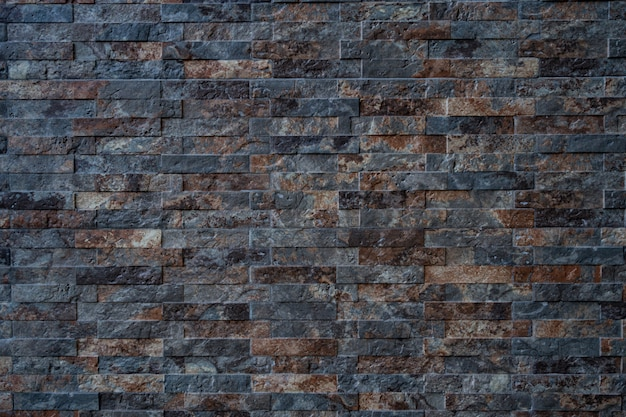 Texture of black with brown brick stone wall