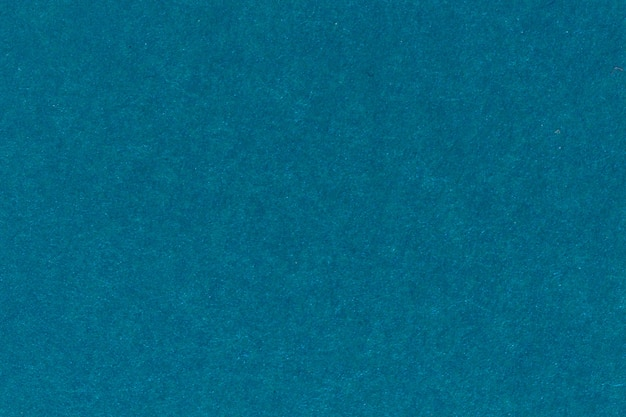 Texture of blue color a brushed paper sheet for blank and pure backgrounds. high resolution photo.