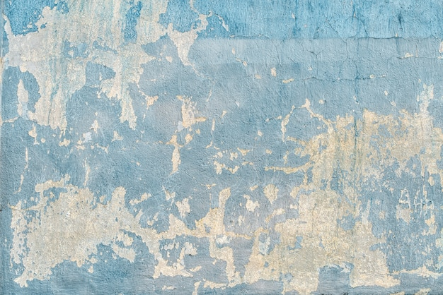 Texture of blue cracked wall in scratches