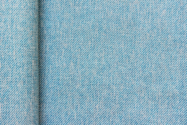 Texture of blue fabric cloth textile with a fold and copy blank space
