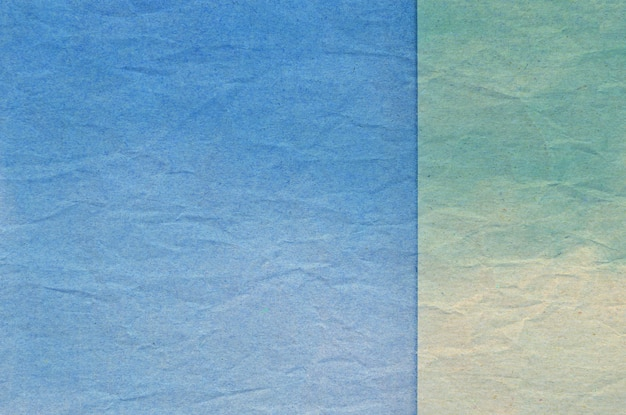 Texture of blue and green crumpled paper