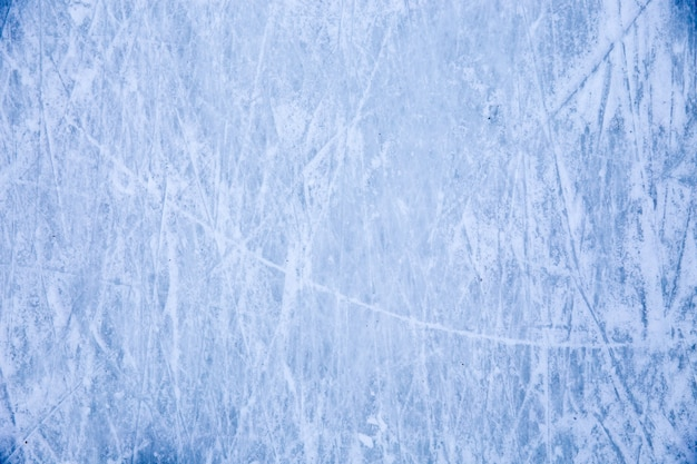 Texture of blue ice surface with skate scratches
