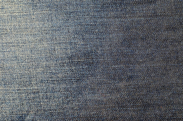 Texture of the blue jeans.  fabric background