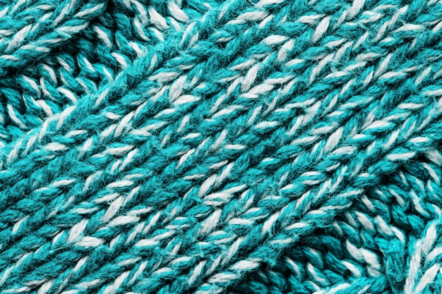 Texture of a blue knitted sweater.