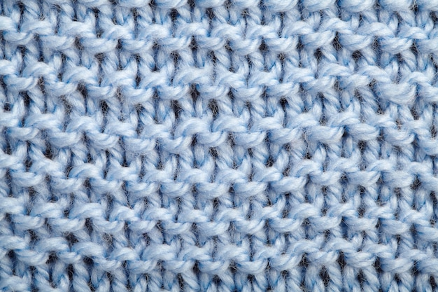 The texture of a blue knitted woolen fabric