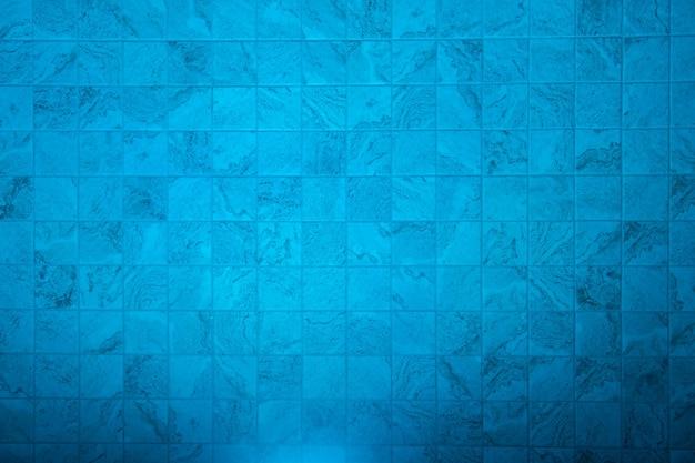 Texture blue pool bottom illuminated