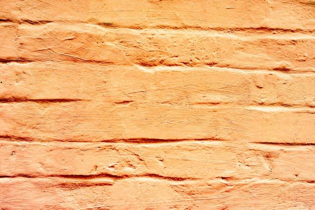 텍스처 벽돌 벽 배경입니다. 긁힘 및 균열이있는 벽돌 질감