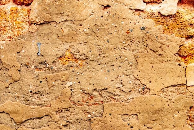 Текстура кирпичной стены фон. текстура кирпича с царапинами и трещинами