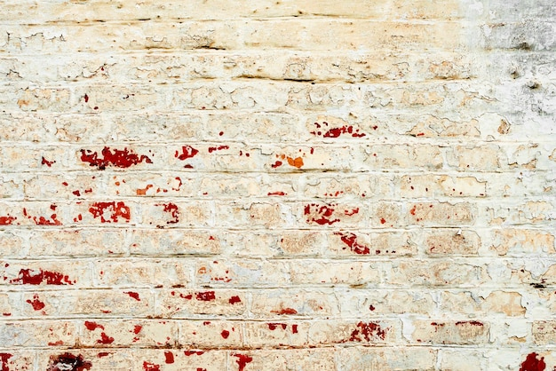 テクスチャ、レンガ、壁、背景として使用できます。傷やひび割れのあるレンガの質感
