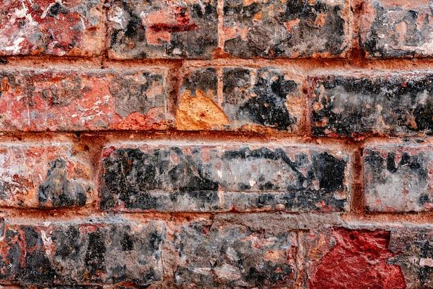 Texture, brick, wall, it can be used as a background. brick texture with scratches and cracks
