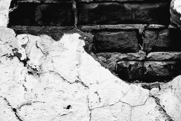 Texture of a brick wall with cracks and scratches background