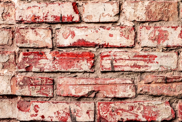 Texture of a brick wall with cracks and scratches