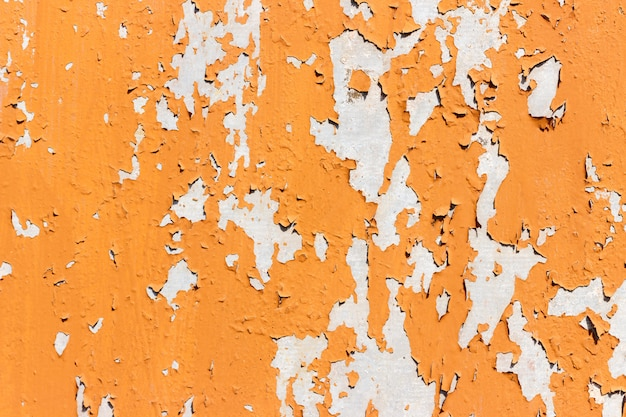 Texture of bright orange paints shabby metal background