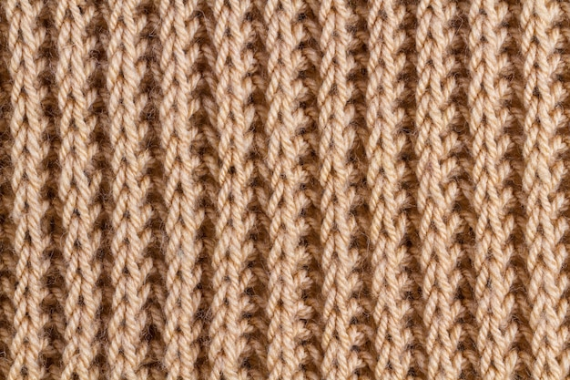 The texture of a brown knitted yarn. knitted and winter clothes