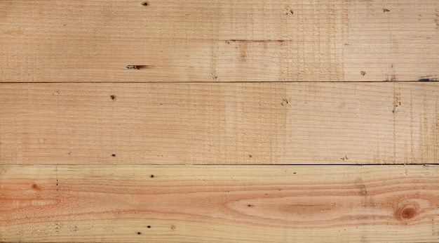 Texture of brown wooden planks as background.