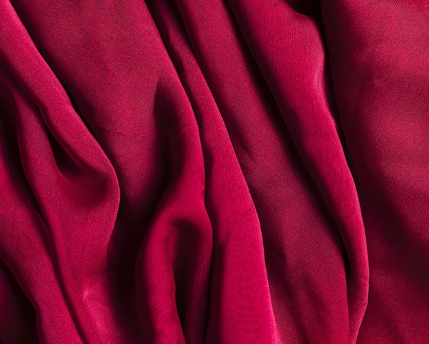 Texture of burgundy red crumpled fabric