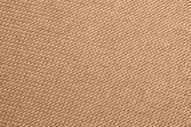 Texture of burlap, brown woven fabric background. sackcloth surface, sacking material, bagging textile wallpaper close-up.