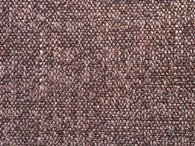 Texture of canvas fabric handmade with a two-color interlacing of yarns in stylish fashionable rustic design