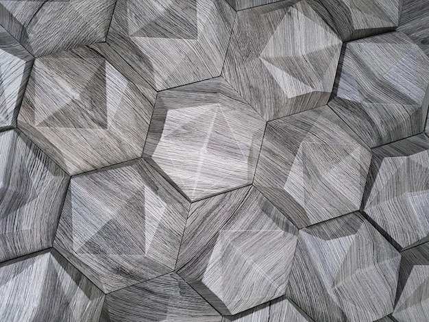 The texture of the ceramic tiles in the form of a hexagon made of natural stone of gray color with convex surfaces of a triangular shape background