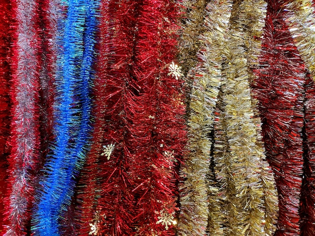 Texture. christmas tinsel to decorate the christmas tree and interior.
