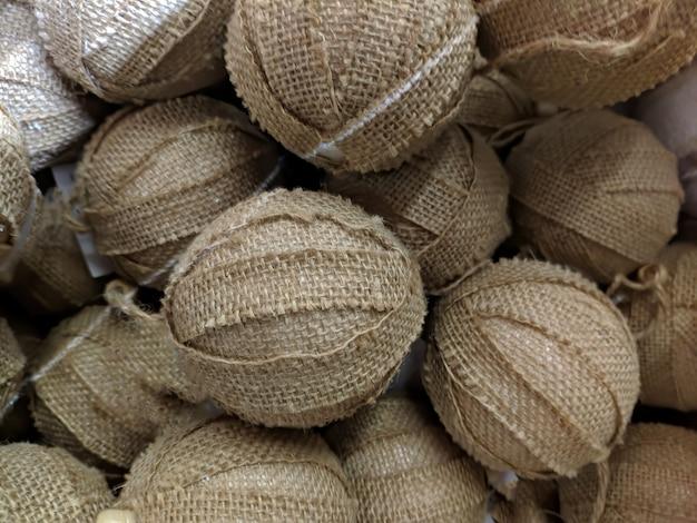 Texture. christmas tree toys close-up. burlap balls. fabric.