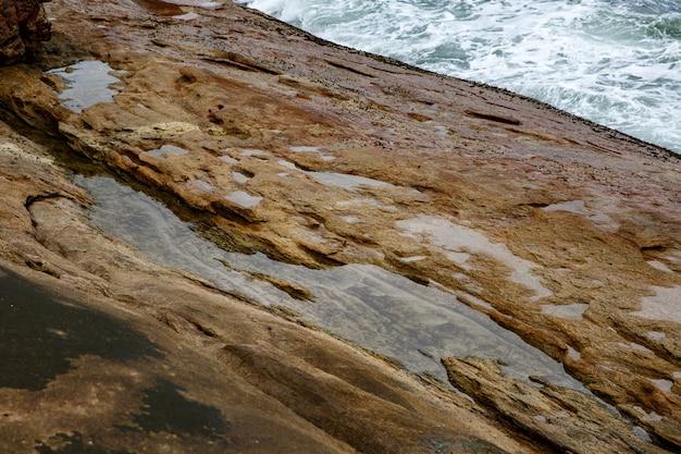 Texture of coastal old stone. rock wallpaper.