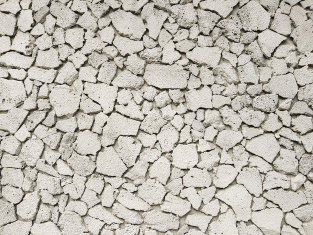 Texture of concrete in grey tone with cracked surface and dirt in cracks.old gray concrete wall for background. concrete texture in white tone with very rough surface and large, deep cracks.