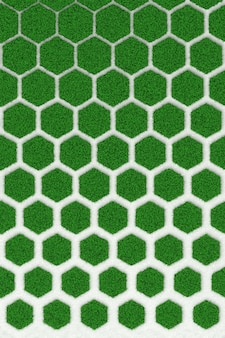 The texture of the concrete honeycomb overgrown green lawn. 3d illustration