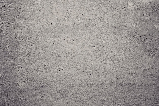 Texture of concrete and plaster on the wall. wavy lines in the plaster. texture of decorative plaster or stucco close up, abstract gray background.